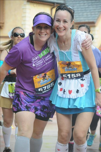 One mile from the finish line of the Walt Disney World marathon and we had to walk it in. My BRF's ankle was DONE with running.