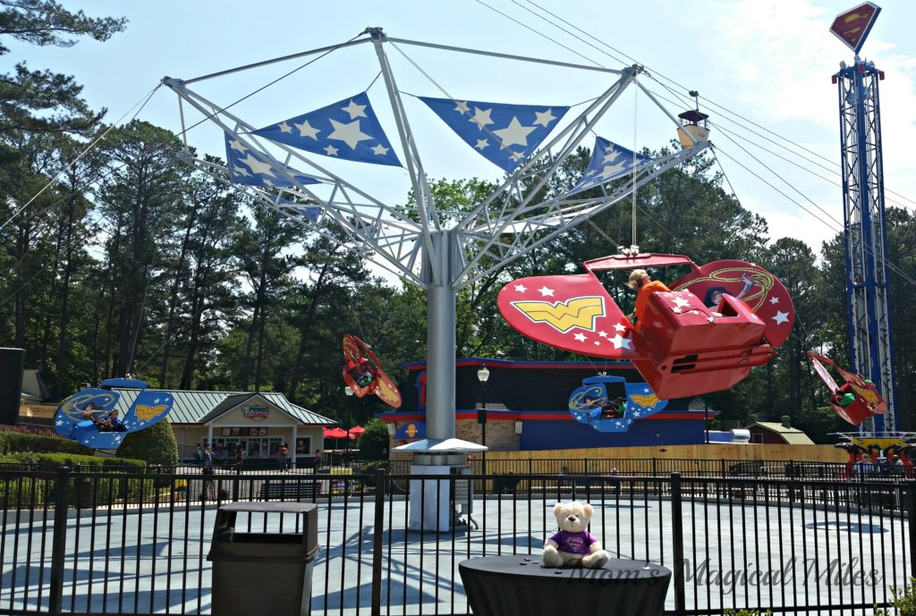 Younger Six Flags Over Georgia guests love rides like Wonder Woman's Flight School in the DC Super Friends area.