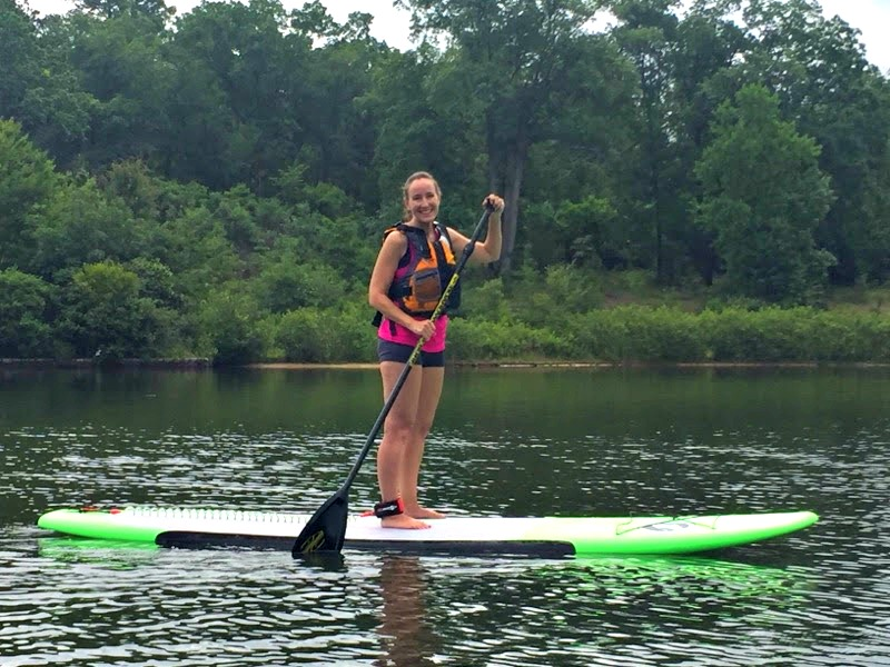 The lake at Stone Mountain Park is a peaceful and lovely setting for stand up paddleboarding through the REI Boathouse!